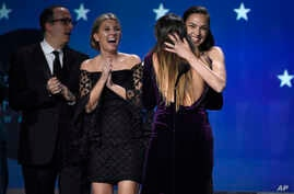 "Gal Gadot and Patty Jenkins embrace as ""Wonder Woman"" wins the award for best action movie at the 23rd annual Critics' Choice Awards at the Barker Hangar on Jan. 11, 2018, in Santa Monica, Calif."