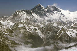 FILE - Mount Everest, the highest peak in the world with an altitude of 8,848 metres (29,028 feet), is seen in this aerial view March 25, 2008. Everest is part of the Himalayan mountain range along the border of Nepal and Tibet. On May 29, 1953.