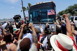 Demonstrators block a bus with migrant children onboard, during a protest outside the U.S. Border Patrol Central Processing Center, in McAllen, Texas, June 23, 2018.