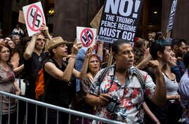Protesters shout slogans in front of Trump Tower ahead President Donald Trump's visit to the building New York, Aug. 14, 2017.
