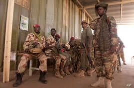 FILE - In this picture provided by the French Army Communications Audiovisual office (ECPAD), Chad soldiers for the African-led international support mission to Mali wait to board an aircraft in N'Djamena, Chad, bound for Bamako, the capital of Mali,
