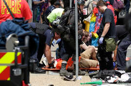 "Rescue workers assist people who were injured when a car drove through a group of counter protestors at the ""Unite the Right"" rally Charlottesville, Virginia, Aug. 12, 2017."