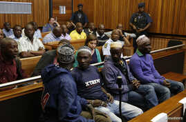 Four men (front row) accused of trying to kill former Rwandan army chief General Faustin Kayumba Nyamwasa, an exiled critic of Rwandan President Paul Kagame in South Africa, attend court proceedings in Kagiso, outside Johannesburg, Sept. 10, 2014.