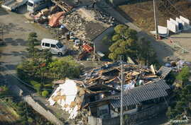 Collapsed houses caused by an earthquake are seen in Mashiki town, Kumamoto prefecture, southern Japan, April 15, 2016.