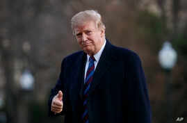 President Donald Trump gives the thumbs-up as he arrives on Marine One on the South Lawn of the White House in Washington, Feb. 8, 2019, as he returns from his annual physical exam at Walter Reed National Military Medical Center.