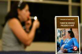 """FILE - A Brazilian cigarette pack depicts a photograph of a pregnant smoker with the caption """"The Ministry of Health warns: Smoking during pregnancy is detrimental to child's health."""""""