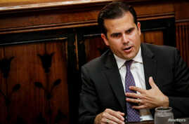 FILE - Puerto Rico Governor Ricardo Rossello speaks during an interview in New York City, Nov. 2, 2017.