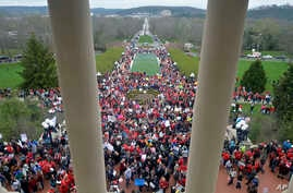 Thousands of teachers from across Kentucky gather outside the state Capitol to rally for increased funding and to protest last minute changes to their state funded pension system, April 2, 2018, in Frankfort, Ky.