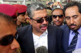 Yemen's Vice President Khaled Bahah, center, talks to reporters upon his arrival at Aden airport, August 1, 2015.
