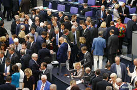 Deputies vote during the session of Germany's parliament, the Bundestag, in Berlin, Germany, July 17, 2015.