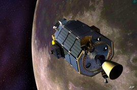 An artist's rendition provided by NASA shows the Lunar Atmosphere and Dust Environment Explorer (LADEE) spacecraft orbiting the moon as it prepares to fire its maneuvering thrusters to maintain a safe orbital altitude, April 18, 2014.