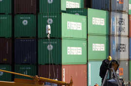 A man works at a container area at a port in Tokyo January 25, 2012.