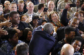 President Barack Obama shakes hands after addressing troops at Joint Base McGuire-Dix-Lakehurst, in New Jersey, Dec. 15, 2014.