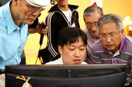 South Korean applicants check their names of candidates who will be allowed to meet their North Korean relatives in upcoming family reunions at the headquarters of Korea Red Cross in Seoul, South Korea, Aug. 24, 2013.
