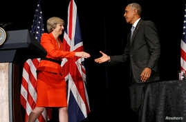 Britain's Prime Minister Theresa May (L) and U.S. President Barack Obama shake hands after speaking to reporters following their bilateral meeting alongside the G20 Summit, in Ming Yuan Hall at Westlake Statehouse in Hangzhou, China, September 4, 201...