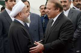 In this photo released by Press Information Department, Pakistan's PM Nawaz Sharif (R) receives visiting Iranian President Hassan Rouhani in Islamabad, Pakistan, March 25, 2016. This is Rouhani's first visit to Pakistan since taking office.