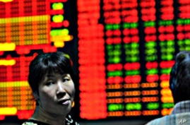 Asian Markets Mixed After Surprise China Interest Rate Increase
