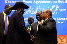 FILE - South Sudan President Salva Kiir, Sudan's President Omar Al-Bashir and South Sudan rebel leader Riek Machar are seen after peace talks in Khartoum, Sudan, June 27, 2018.