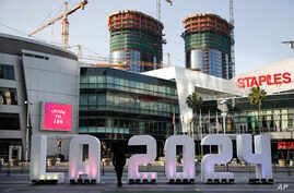 A Los Angeles 2024 sign stands in front of Staples Center in Los Angeles, May 11, 2017.