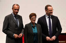 Christian Democratic Union (CDU) candidates Friedrich Merz, Annegret Kramp-Karrenbauer and Jens Spahn arrive at a regional conference in Luebeck, Germany, Nov. 15, 2018.