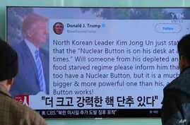 "People watch a TV news program showing the Twitter post of U.S. President Donald Trump  in Seoul, South Korea, Jan. 3, 2018. Trump boasted that he has a bigger and more powerful ""nuclear button"" than North Korean leader Kim Jong Un."