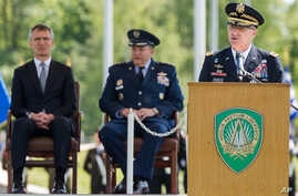 New NATO's Supreme Allied Commander Europe, U.S. Army General Curtis  M. Scaparrotti, right, delivers a speech as NATO Secretary General Jens Stoltenberg, left, and former NATO's Allied Commander Europe U.S. General Philip M. Breedlove listen during