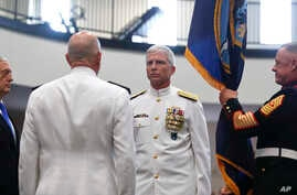 Secretary of Defense James Mattis, left, U.S. Navy Adm. Kurt Tidd, center left, U.S. Navy Adm. Craig Faller, center right, stand during a change of command ceremony at the U.S. Southern Command headquarters, Nov. 26, 2018, in Doral, Florida.