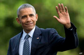 FILE - President Barack Obama waves as he walks across the South Lawn of the White House, in Washington.