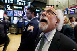 Trader Peter Tuchman works on the floor of the New York Stock Exchange, Oct. 10, 2018. The Dow Jones industrial average plunged more than 800 points, its worst drop in eight months, led by sharp declines in technology stocks.