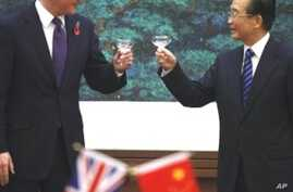 British Prime Minister David Cameron and Chinese Premier Wen Jiabao toast a signing ceremony at the Great Hall of the People in Beijing, 09 Nov 2010