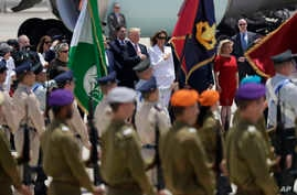 US President Donald Trump, background centre left and first lady Melania Trump participate in an arrival ceremony at Ben Gurion International Airport, May 22, 2017.