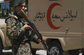 An Afghan soldier patrols outside a hospital in Kabul