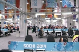 Media Workroom inside of the Olympic Press Center, Olympic Village, Sochi, Russia, Feb. 16, 2014. (Parke Brewer/VOA)