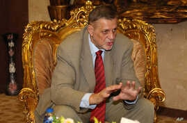Jan Kubis, the U.N. Secretary-General's Special Representative for Iraq and Head of the United Nations Assistance Mission for Iraq (UNAMI), meets with the spiritual leader of the Sabean Mandaean religious minority, Sheik Sattar Jabbar, in Baghdad, Ir