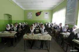 FILE - Class 11 Afghan girl students attend a class at Zarghona high school in Kabul, Afghanistan, Aug. 15, 2015.