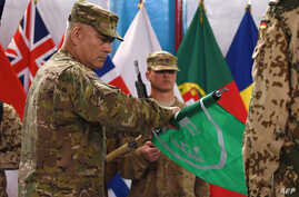 US General John Campbell (L) rolls the flag of the NATO-led International Security Assistance Force (ISAF) during a ceremony marking the end of ISAF's combat mission in Afghanistan at ISAF headquarters in Kabul,  Dec. 28, 2014.