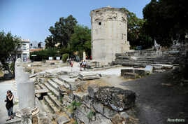 Tourists visit the Tower of the Winds, open to the public for the first time in more than 200 years after being restored, in the Roman Agora, in Plaka, central Athens, Greece, Aug. 23, 2016.