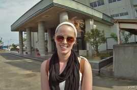 Kate O'Berg in front of one of the schools in Japan where she now teaches.(T.Banse/VOA)