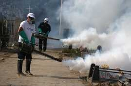 FILE - Health workers fumigate to prevent Dengue, Chikunguya and Zika virus, at El Angel cemetery, in Lima, Peru, Jan 20, 2016.
