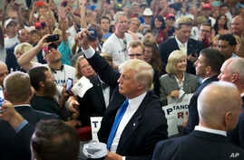 Republican presidential candidate Donald Trump greets the crowd and signs autographs during a campaign rally at the Sharonville Convention Center, Wednesday, July 6, 2016, in Cincinnati.