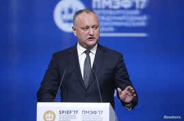 Moldovan President Igor Dodon delivers a speech during a session of the St. Petersburg International Economic Forum (SPIEF), Russia, June 2, 2017.