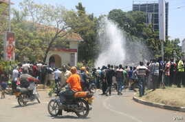 Protesters break a water line in the center of Kisumu, Kenya, during anti-electoral commission protests on October 6, 2017, ahead of the upcoming re-run presidential election. (VOA/J. Craig