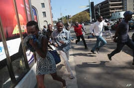 Protesters disperse in Harare Aug. 24, 2016, after Zimbabwe police fired tear gas, water cannon and gunshots to stop hundreds of youths rallying against the government of President Robert Mugabe.