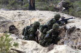Estonian soldiers take part in NATO military exercise Hedgehog 2015 at the Tapa training range in Estonia, May 12, 2015.