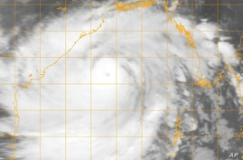 This image provided by the U.S. Naval Research Lab shows Indian Cyclone Phailin, Oct. 11, 2013 at 6:32 a.m. EDT (10:32 GMT).