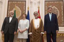 From left, Iranian Foreign Minister Javad Zarif,  European Union adviser Catherine Ashton, Omani Minister Responsible for Foreign Affairs Yussef bin Alawi and US Secretary of State John Kerry meet in Muscat, Oman, Nov. 9, 2014.