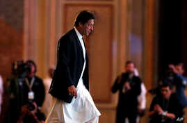 Pakistani Prime Minister Imran Khan prepares to speak at the opening of the Future Investment Initiative conference, in Riyadh, Saudi Arabia, Oct. 23, 2018.