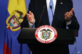 U.S. Secretary of State John Kerry speaks during a joint news conference with Colombia's Foreign Minister Maria Angela Holguin, unseen, at the Presidential Palace in Bogota, Aug. 12, 2013.
