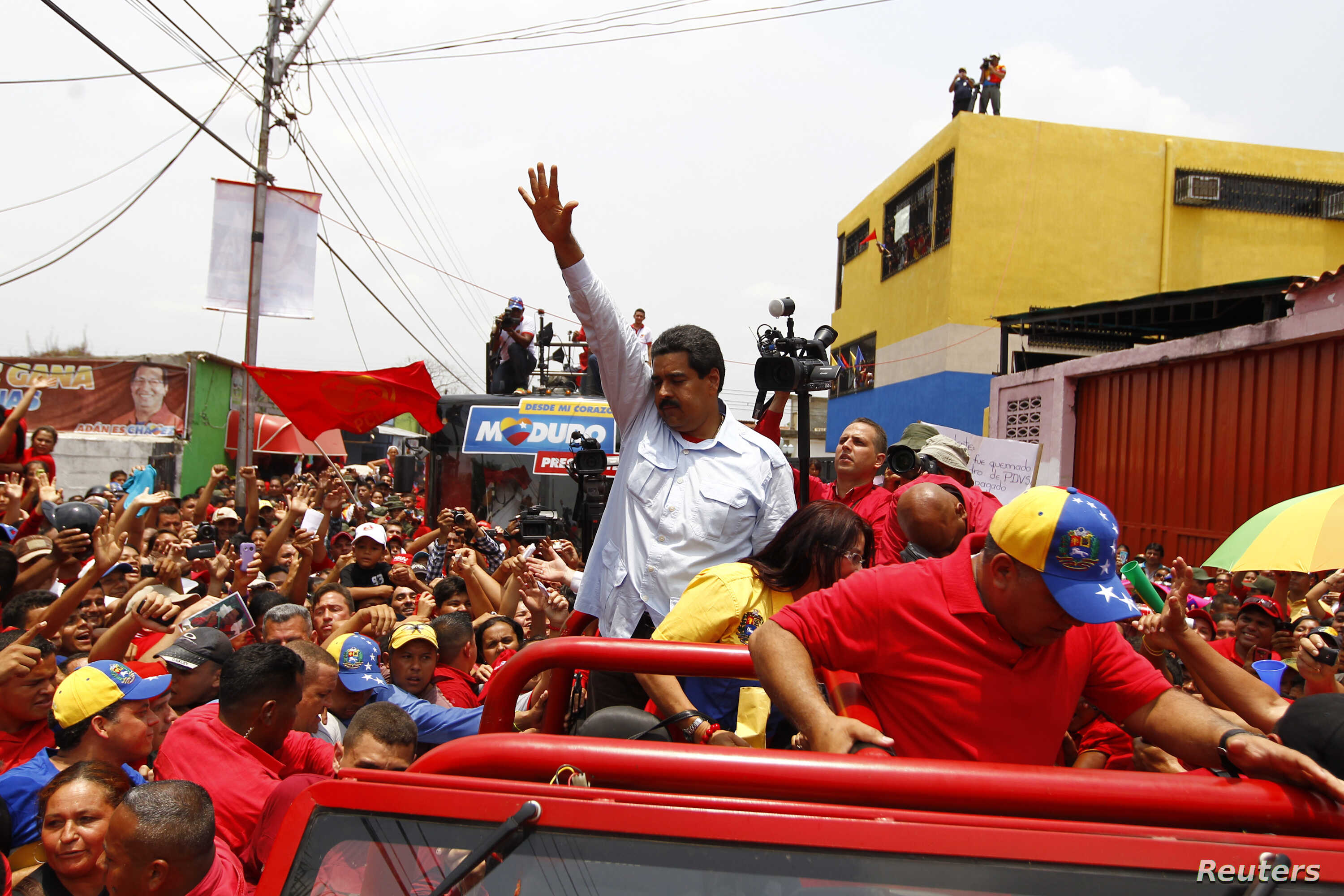 Venezuela's acting President and presidential candidate Nicolas Maduro (C) at campaign rally in state of Barinas April 2, 2013