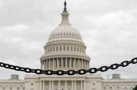 The dome of the U.S. Capitol is seen beyond a chain fence during the partial government shutdown in Washington, Jan. 8, 2019.